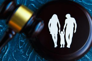 Cutout family picture and a gavel. Family law concept