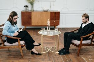 Man undertaking an emotional trauma healing with a therapist