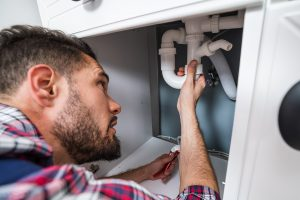 Plumber in Wellington fixing a sink pipe