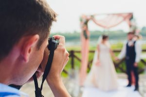 Wedding photographer in Sydney taking pictures of the bride and groom
