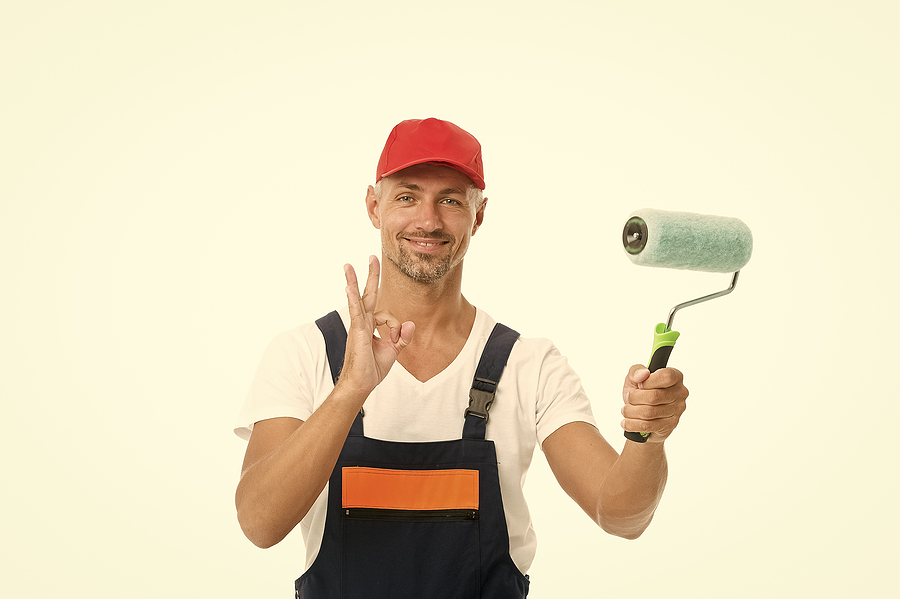 Body corporate painter holding a painting tool